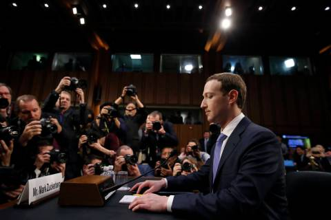 FILE - In this April 10, 2018, file photo Facebook CEO Mark Zuckerberg takes his seat to testif ...
