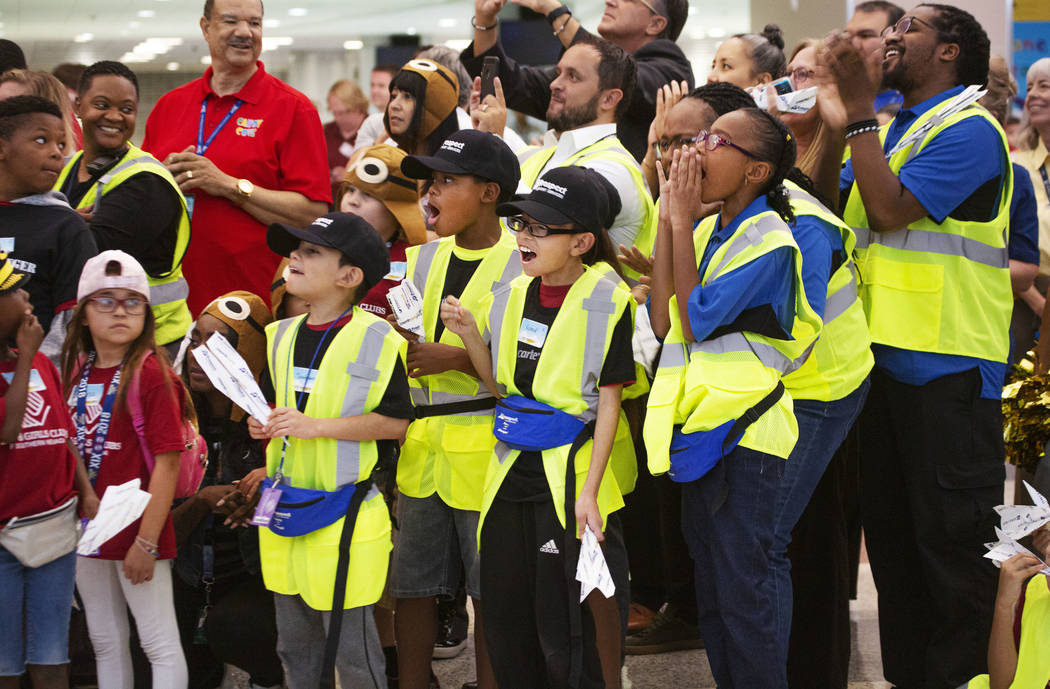 Participants cheer during the seventh annual Paper Plane Palooza in Terminal 3 at McCarran Inte ...