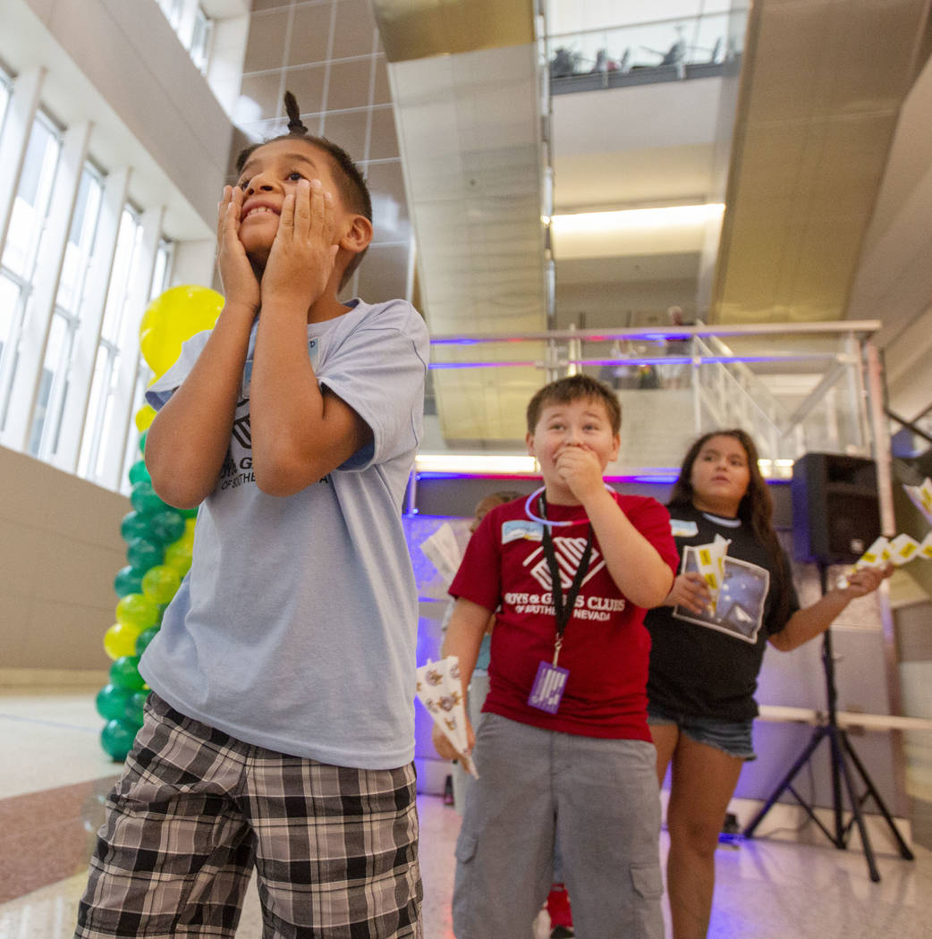 Jaime Rodriguez, 9, looks in shock, as his paper plane becomes stuck by a mirror, as Connor Par ...
