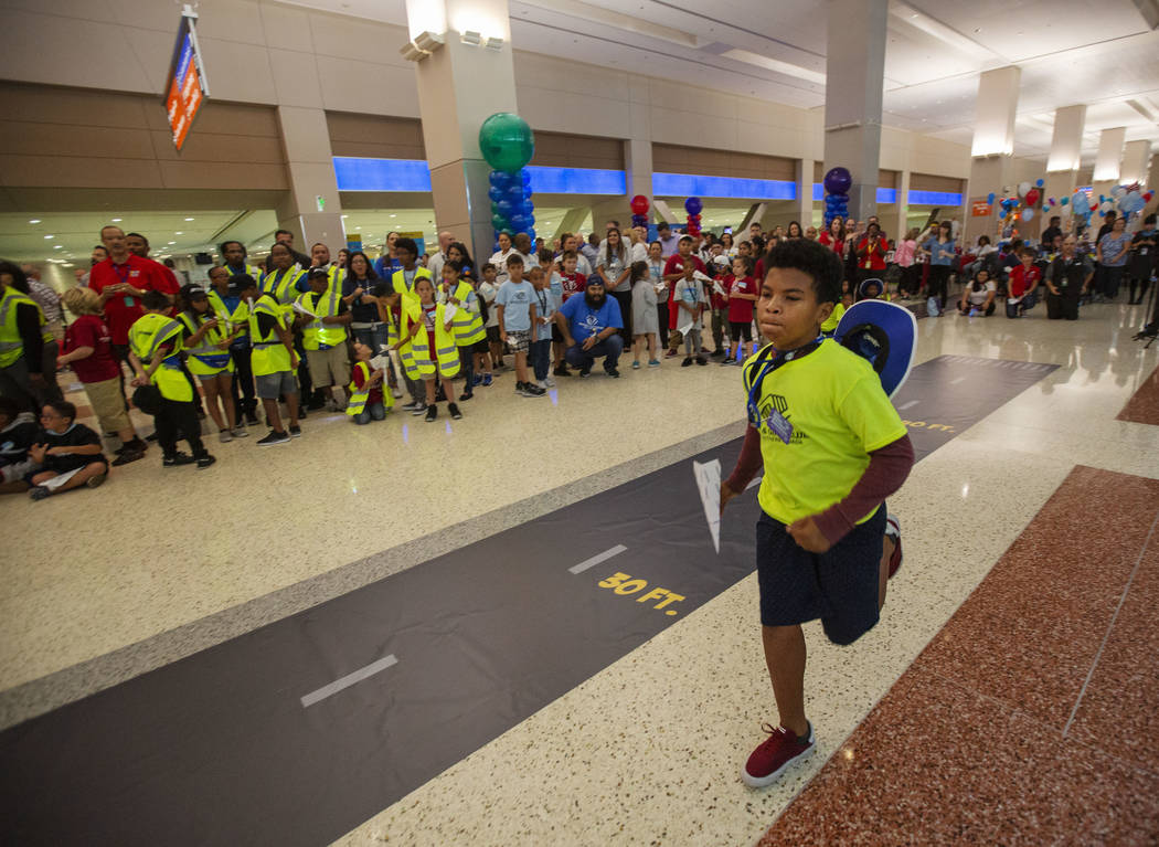 Anwuan Ferguson, 12, runs to his starting point, during the seventh annual Paper Plane Palooza ...