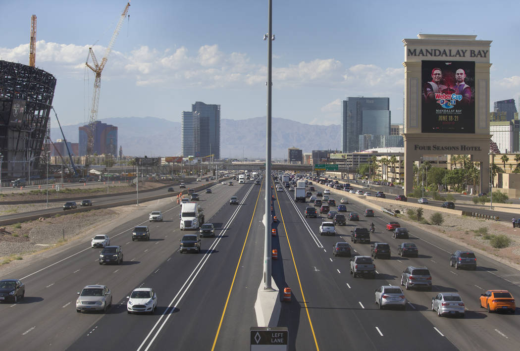 The high occupancy vehicle lanes are largely empty in both directions on Interstate 15 near the ...