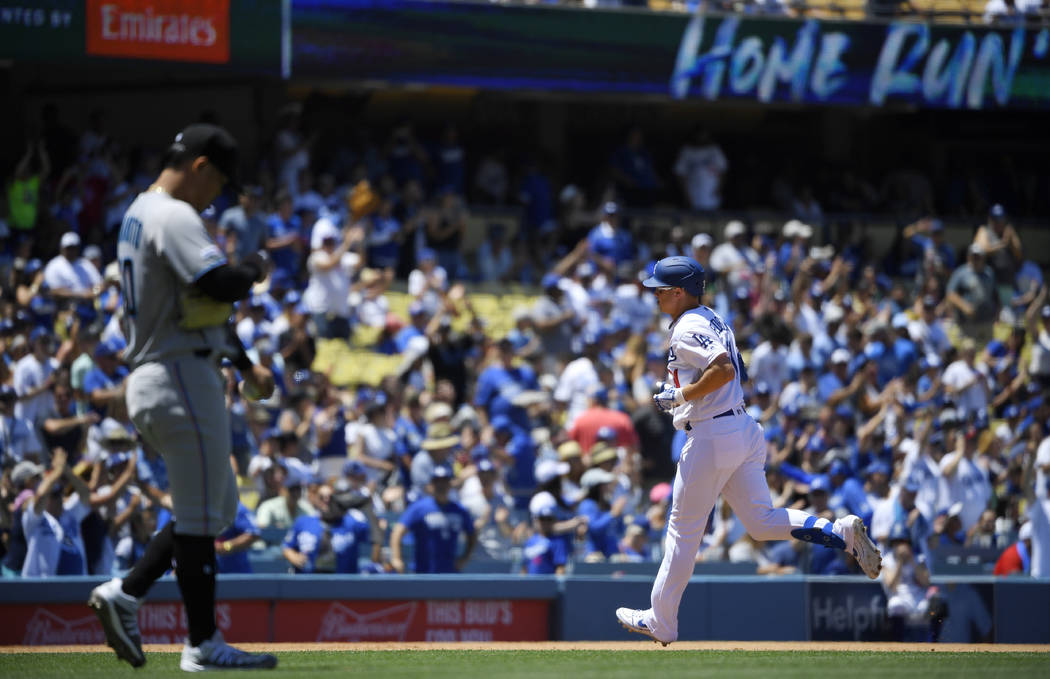 Los Angeles Dodgers' Joc Pederson, right, rounds third after hitting a two-run home run as Miam ...