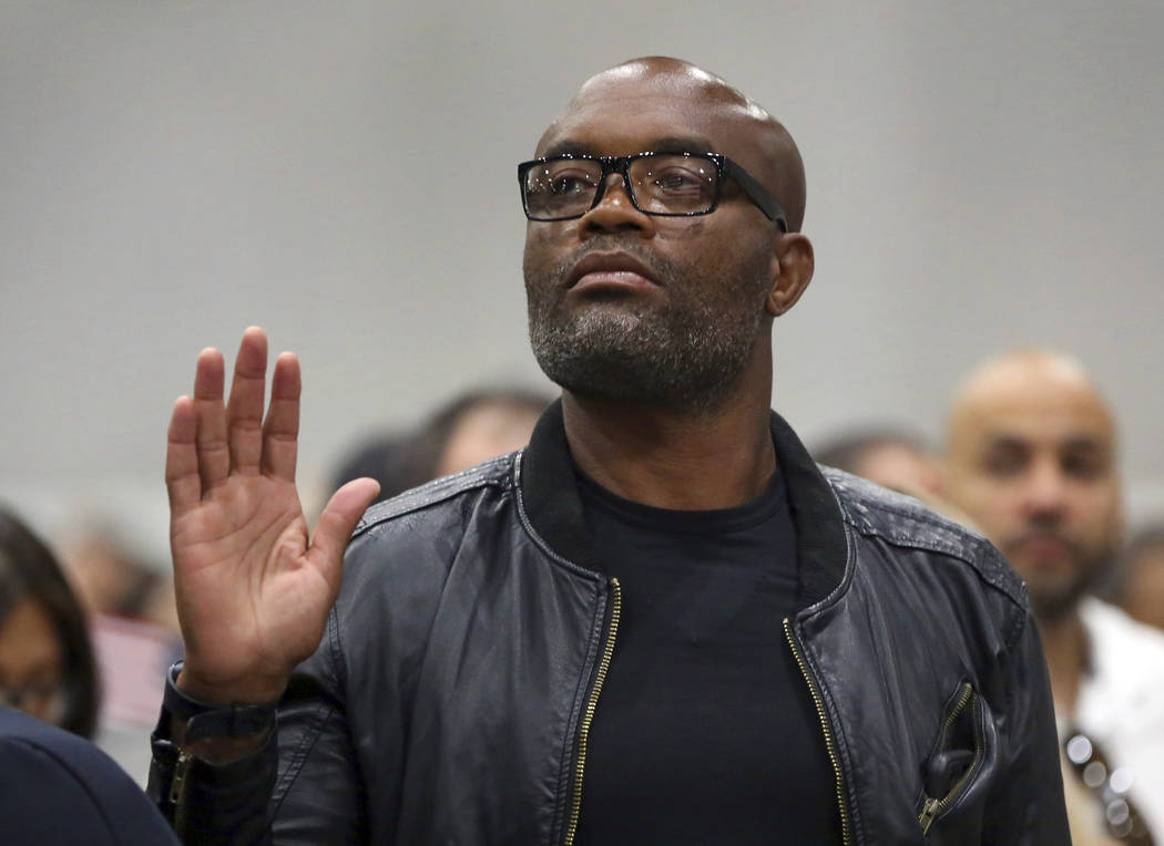 """Mixed martial arts great Anderson """"Spider"""" Silva of Brazil is sworn in as a U.S. citi ..."""