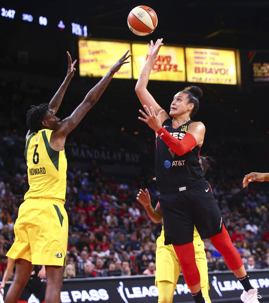 Las Vegas Aces' Kayla McBride shoots over Seattle Storm's Natasha Howard (6) during the second ...