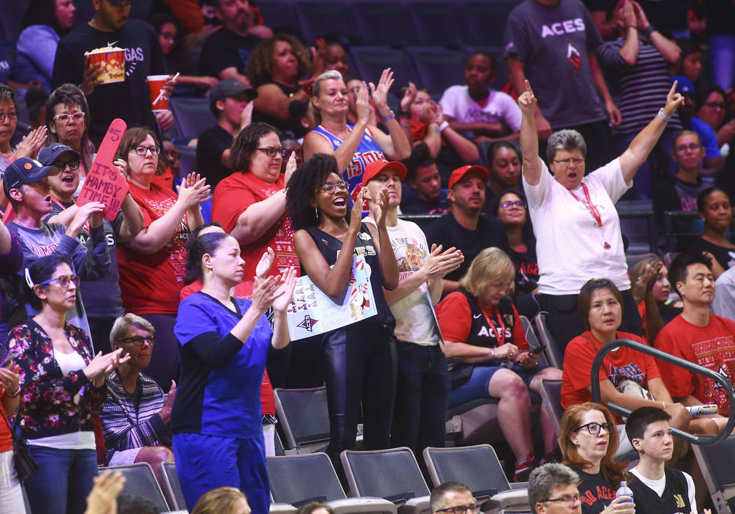 Las Vegas Aces fans cheer during the second half of a WNBA basketball game against Seattle Stor ...