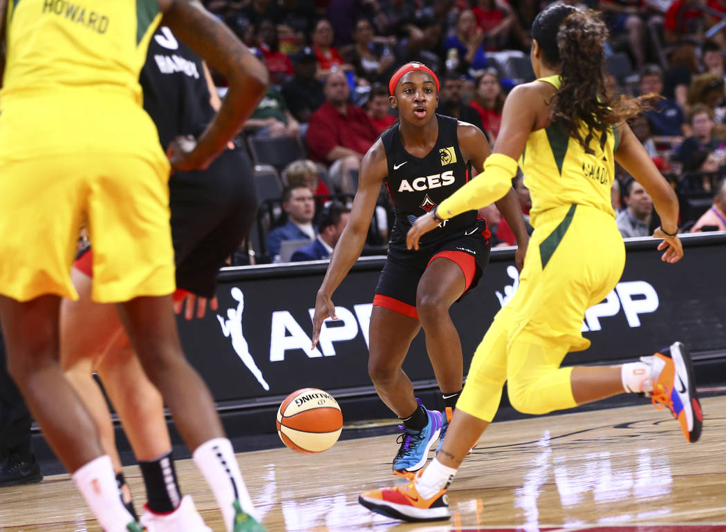 Las Vegas Aces' Jackie Young brings the ball up court against the Seattle Storm during the seco ...