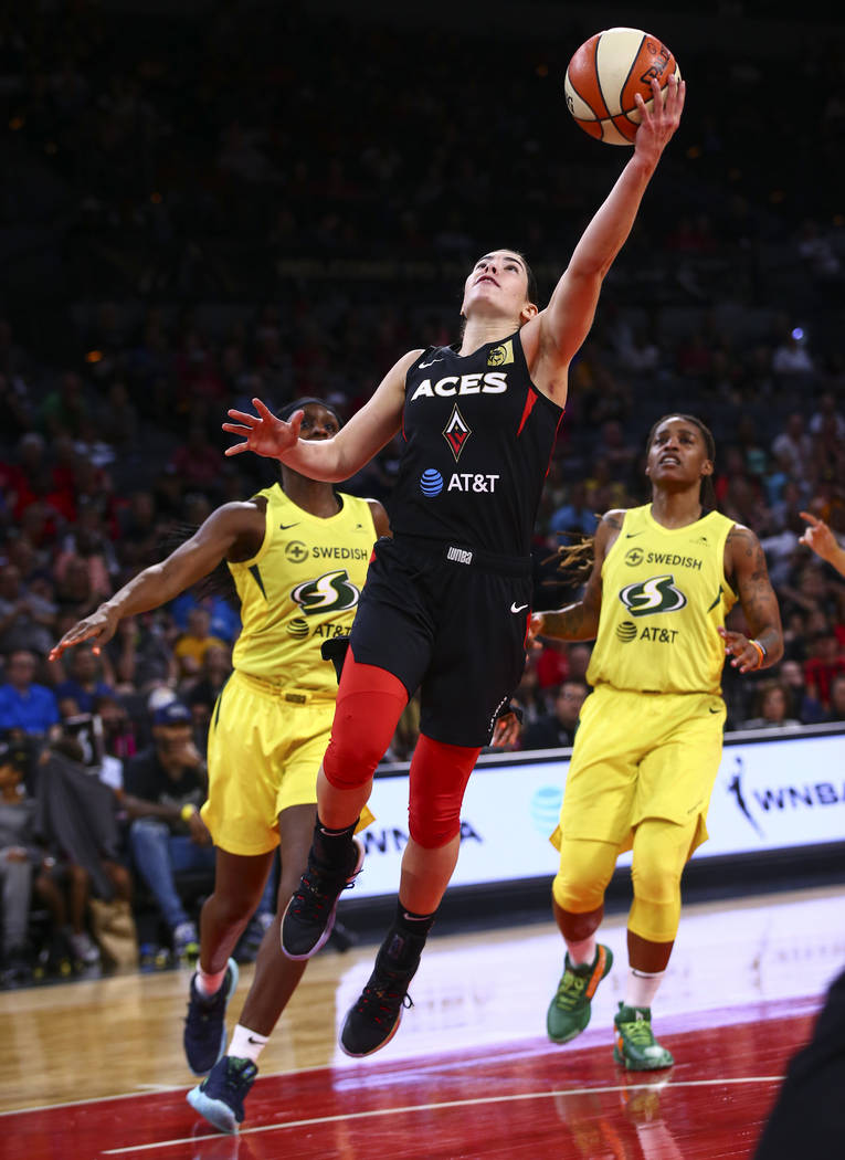 Las Vegas Aces' guard Kelsey Plum (10) goes to the basket against the Seattle Storm during the ...