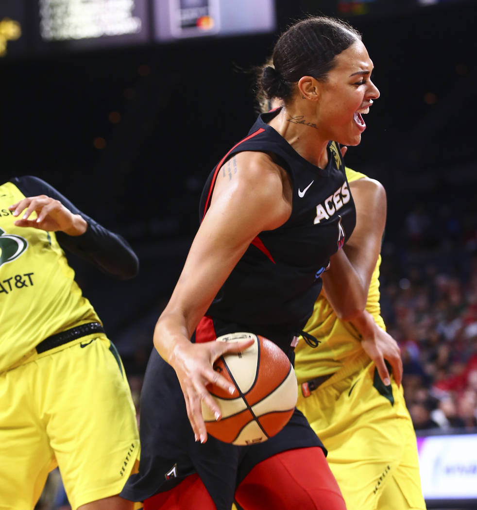 Las Vegas Aces' Liz Cambage drives to the basket against Seattle Storm during the first half of ...