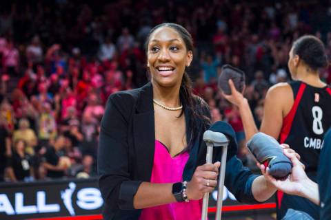 Las Vegas Aces' A'ja Wilson looks to throw t-shirts to the crowd after a WNBA basketball game a ...