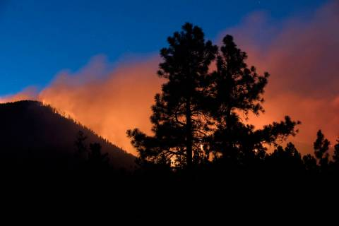 In this Sunday, July 21, 2019, photo, a wildfire burns through the Coconino National Forest, no ...