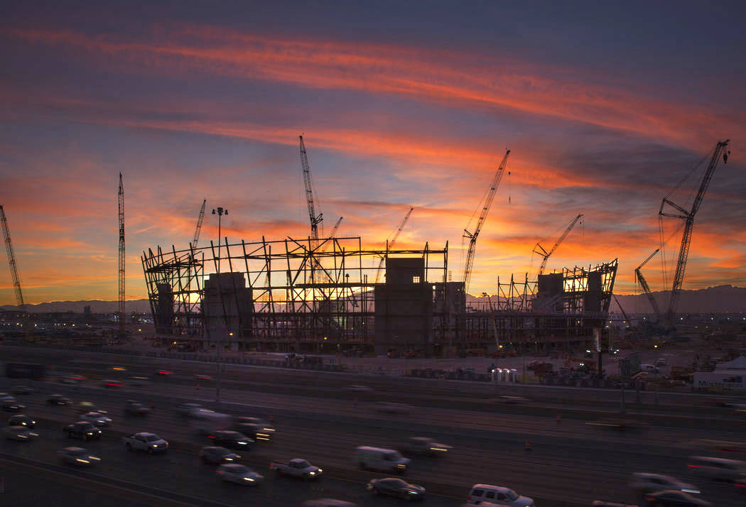 The sun sets behind the under-construction Las Vegas Stadium in Las Vegas on Wednesday, Dec. 19 ...