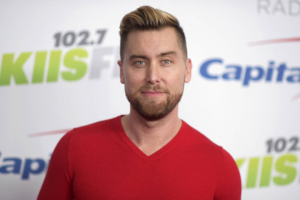 In this Dec. 1, 2017, file photo, Lance Bass arrives at Jingle Ball at The Forum in Inglewood, ...