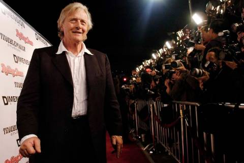 """A March 28, 2005 file photo shows Dutch actor Rutger Hauer arriving at the premiere of """"Sin Cit ..."""