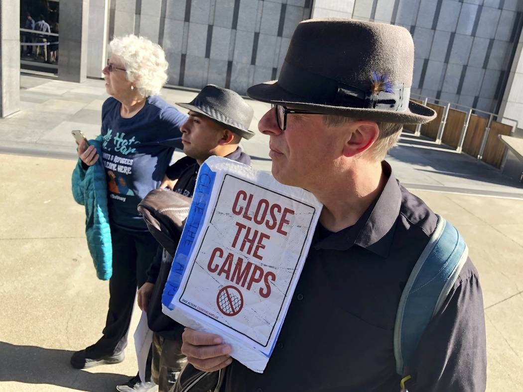 """Ben Terrall holds a protest sign that reads """"Close The Camps"""" outside of the San Fran ..."""
