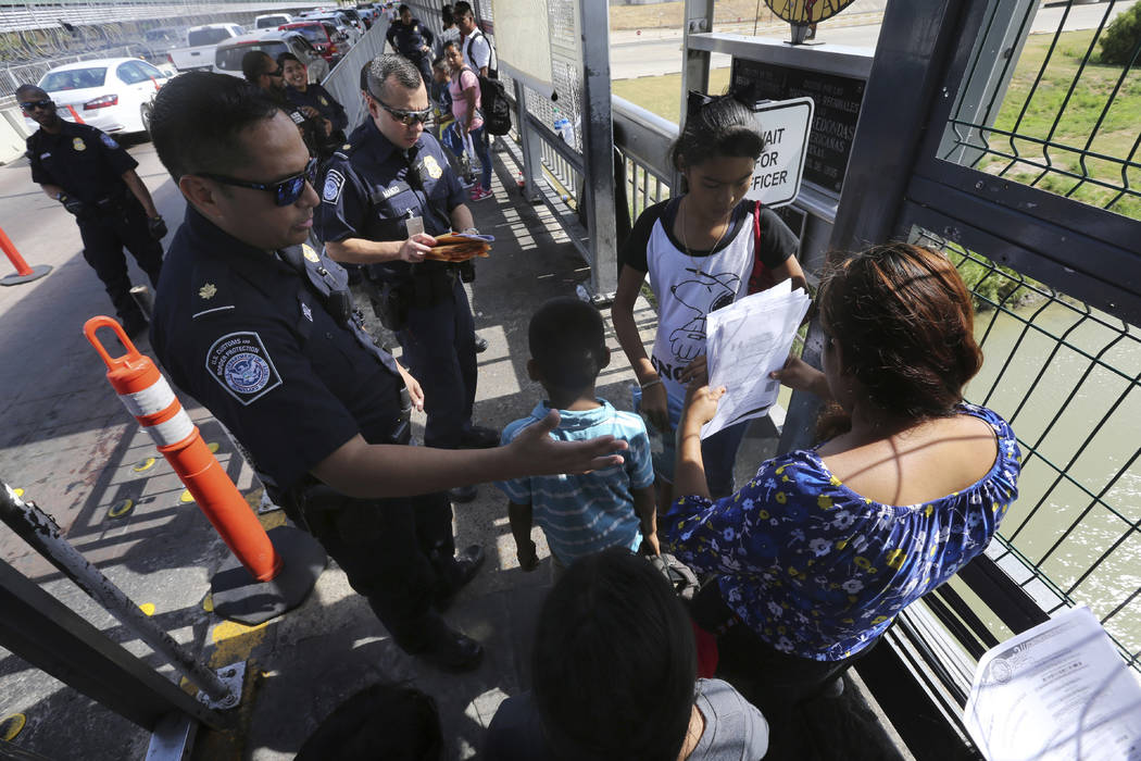 In a July 17, 2019, file photo, a United States Customs and Border Protection Officer checks th ...