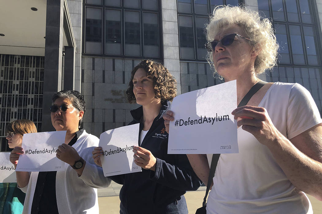 """Protestors hold signs that read """"Defend Asylum"""" outside of the San Francisco Federal ..."""