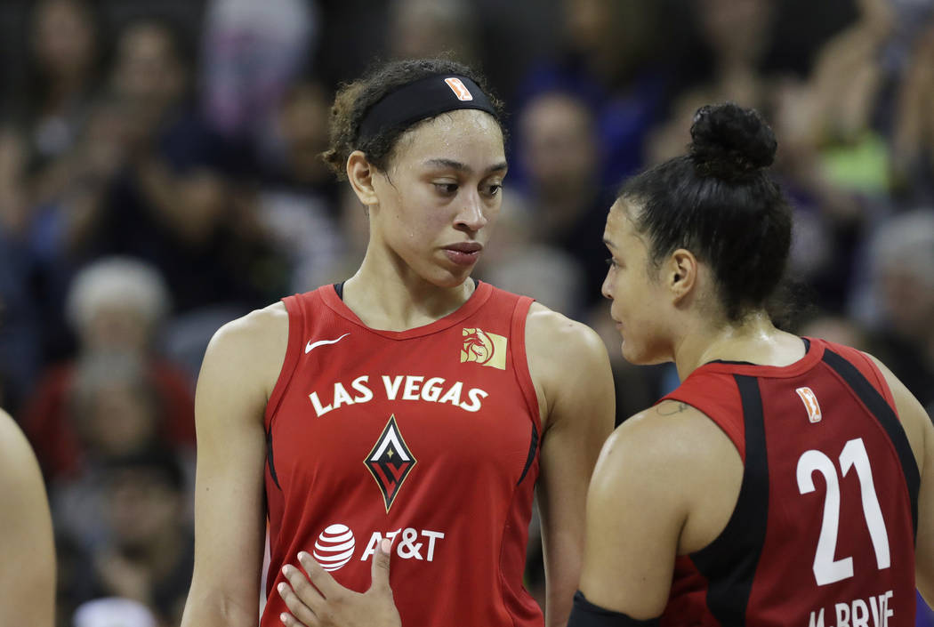 Las Vegas Aces' Dearica Hamby, left, talks with Kayla McBride (21) during a break against the S ...