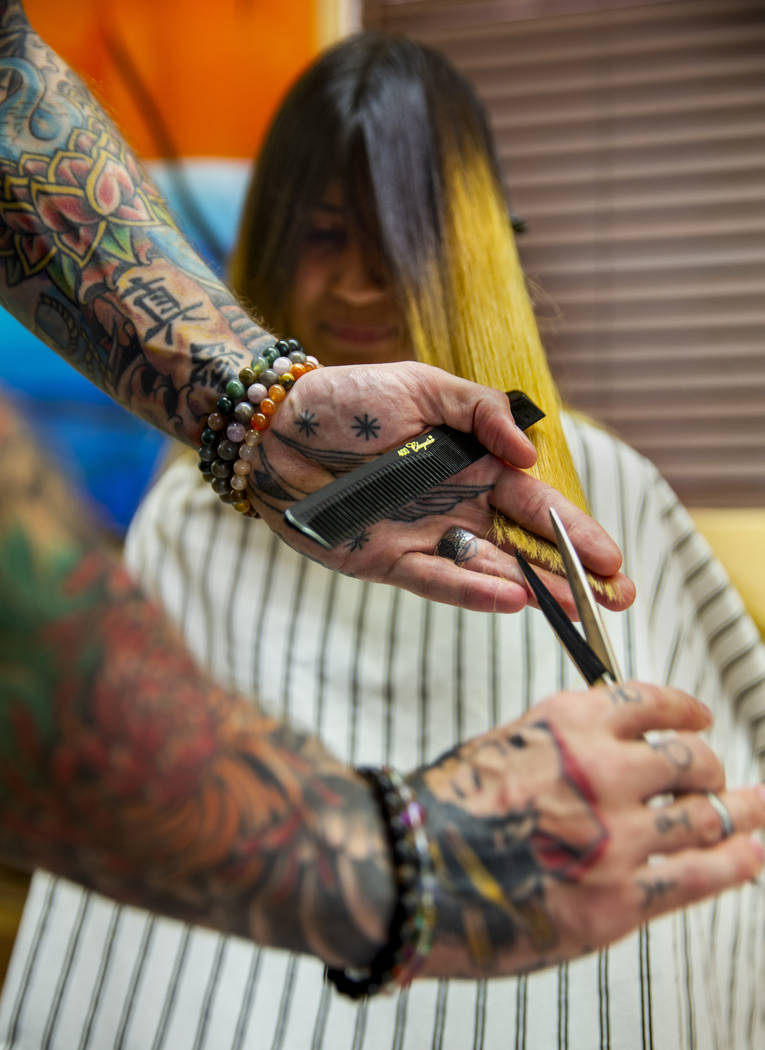 Larissa Garcia has her hair cut by stylist Ryan Glassford during a back-to-school event at the ...