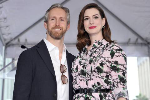 FILE - This May 9, 2019 file photo shows actress Anne Hathaway, right, and her husband Adam Shu ...