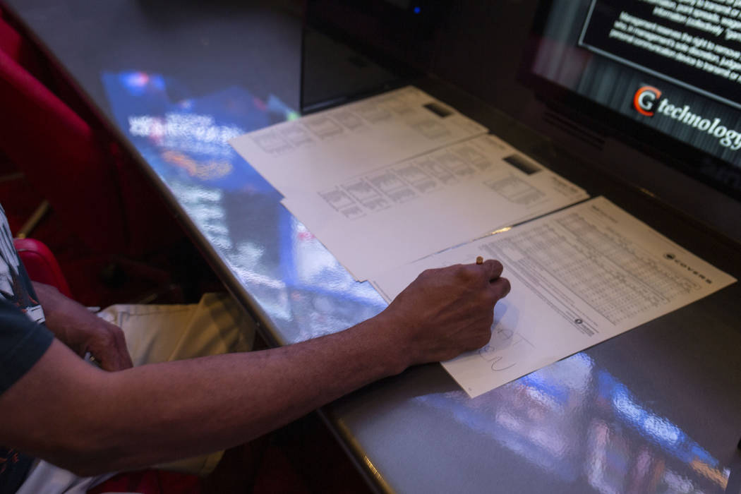 Las Vegas local Al Armer betts on different horse races at the CG Technology sportsbook at the ...