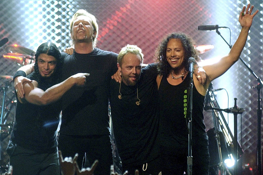 From left, Robert Trujillo, James Hetfield, Lars Ulrich and Kirk Hammett of Metallica take a bo ...