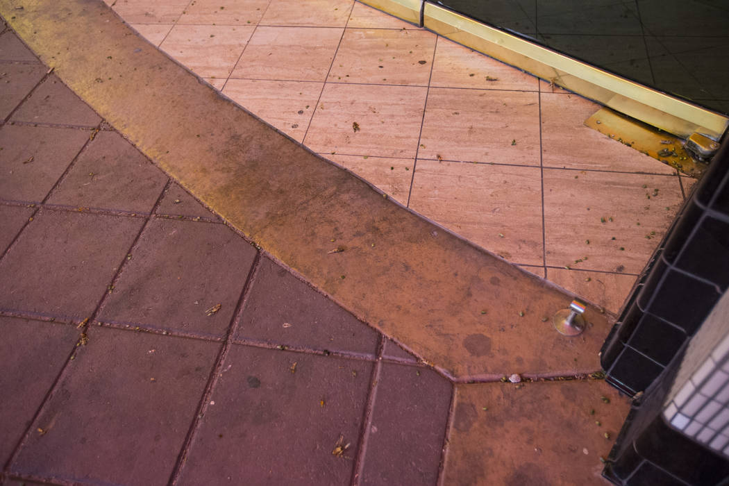 Grasshoppers, some of them dead, are seen outside of the California Hotel in downtown Las Vegas ...