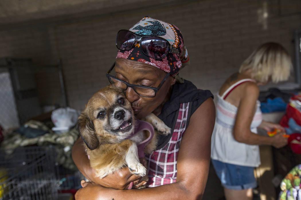 Brenda Shelton kisses her dog Honey Bell at the Courtyard Homeless Resource Center in Las Vegas ...