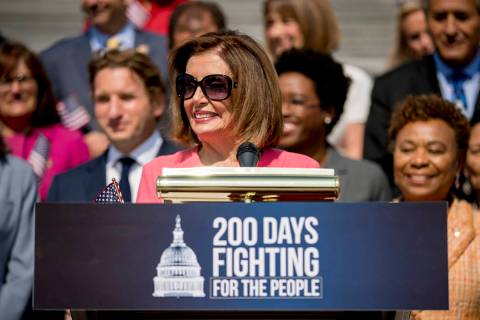 House Speaker Nancy Pelosi of Calif. and House Democrats smiles as she speaks at a news confere ...