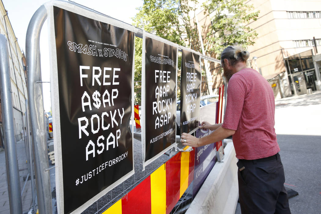 A man displays posters in support of US rapper A$AP Rocky, real name Rakim Mayers, outside the ...