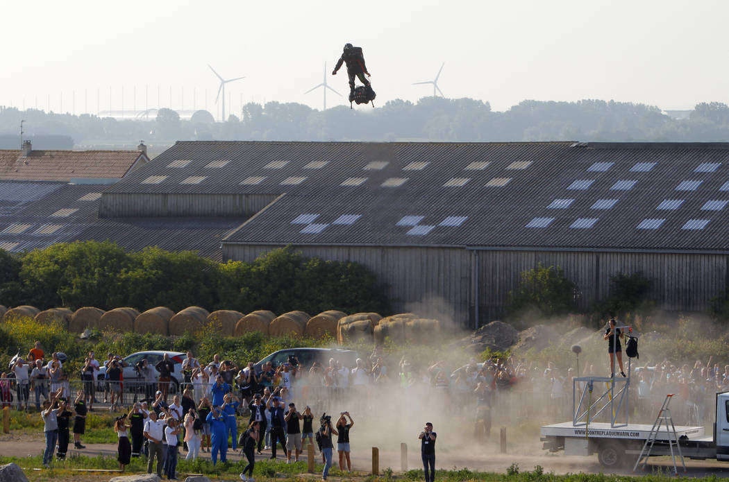 Franky Zapata, a 40-year-old inventor, takes to the air in Sangatte, Northern France, at the st ...