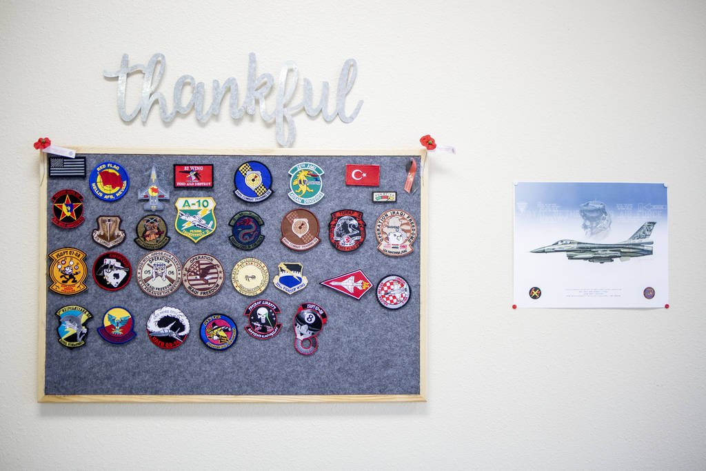 Airforce badges hang on the wall of Former Miss Nevada Lisa Song Sutton's company Ship Las Vega ...