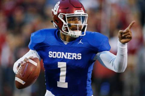 Oklahoma quarterback Jalen Hurts gestures during the NCAA college football team's spring game i ...