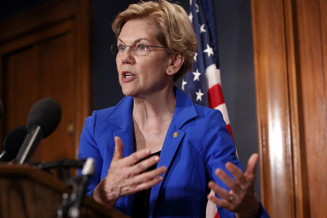 Sen. Elizabeth Warren, D-Mass., speaks about a bill to cancel student loan debt, Tuesday, July ...