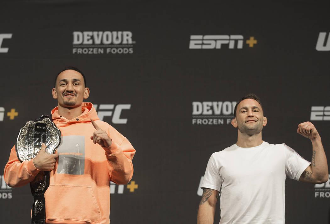 UFC featherweight champion Max Holloway, left, and UFC featherweight contender Frankie Edgar ta ...