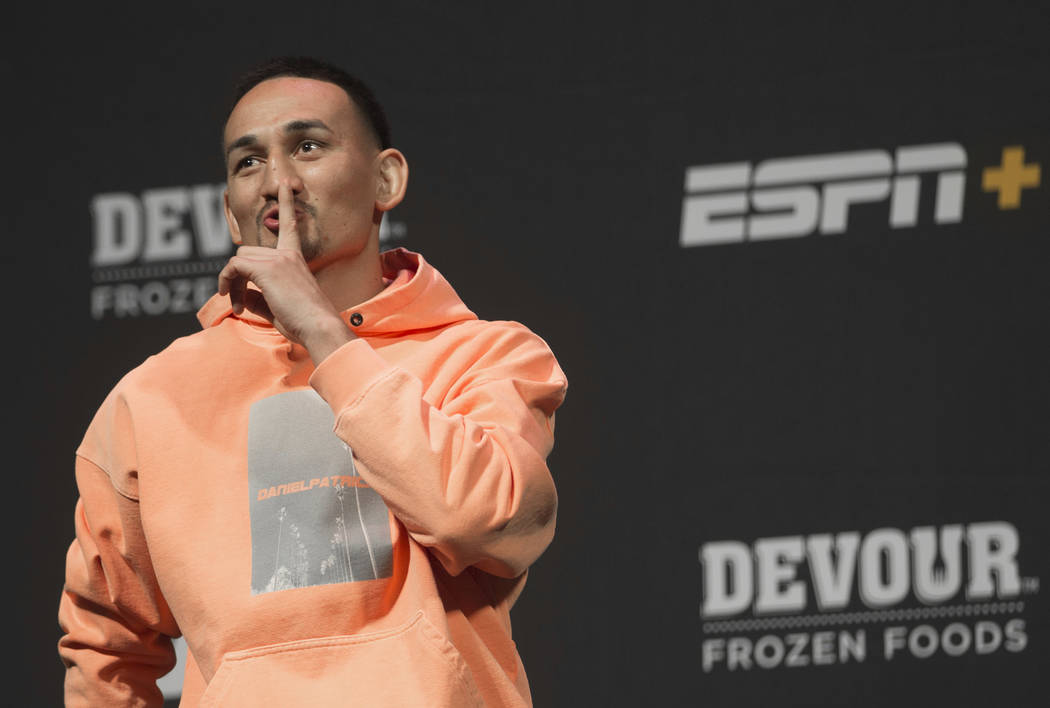 UFC featherweight champion Max Holloway jokes around with the crowd during a press conference o ...
