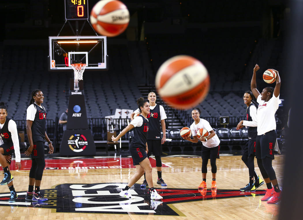 Members of Team Delle Donne shoot half-court shots while practicing ahead of the WNBA All-Star ...