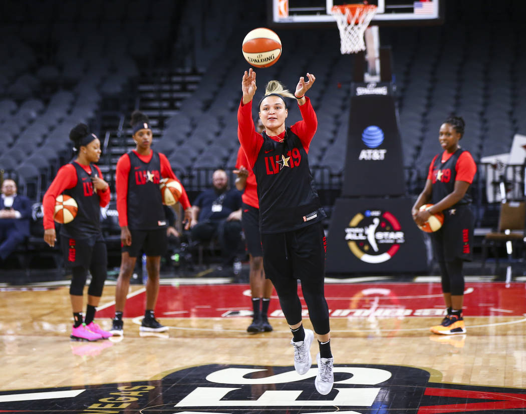 Las Vegas Aces' Kayla McBride attempts a half-court shot during practice ahead of the WNBA All- ...