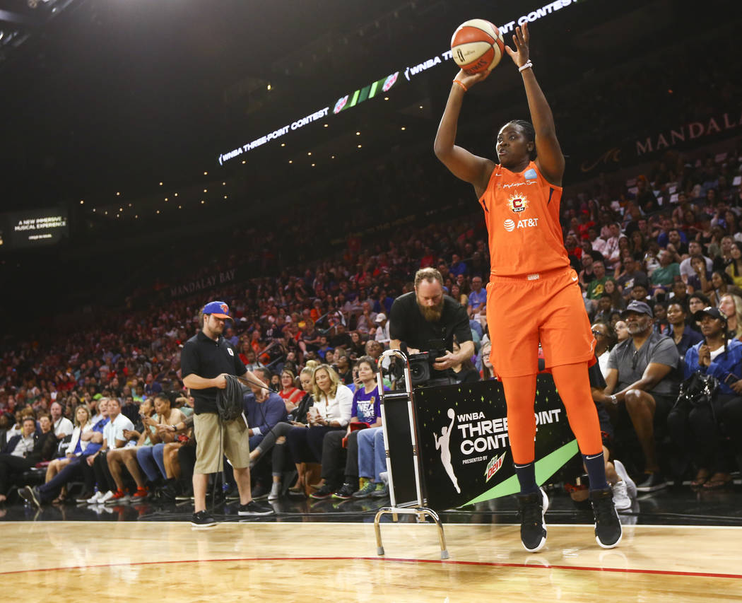 Connecticut Sun's Shekinna Stricklen competes in the three-point shooting challenge during the ...