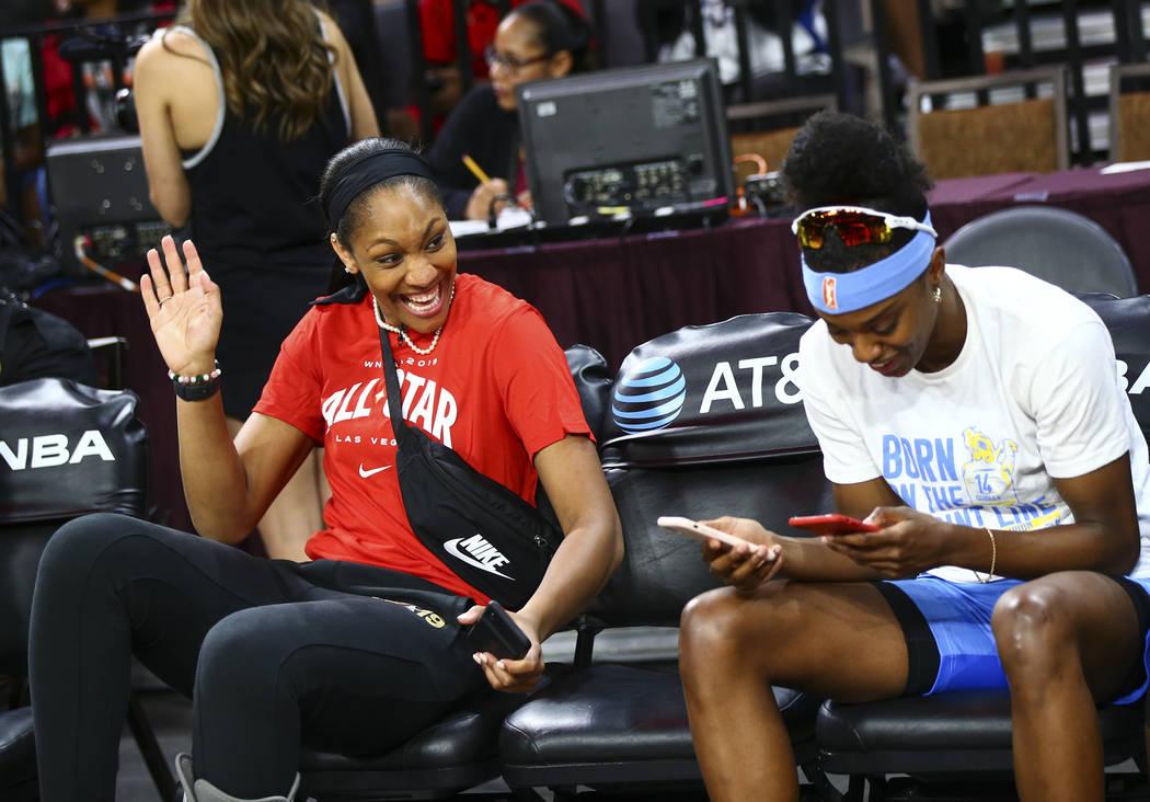 Las Vegas Aces' A'ja Wilson, left, shares a laugh with Chicago Sky's Diamond DeShields competes ...
