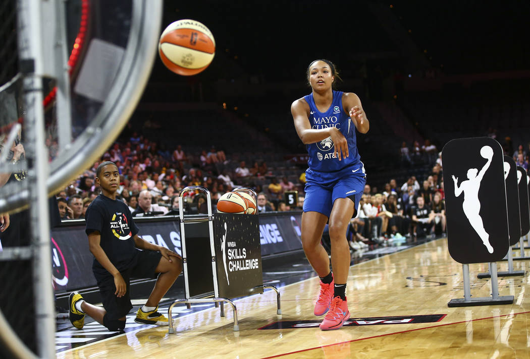 Minnesota Lynx's Napheesa Collier competes in an obstacle course involving passing and shooting ...