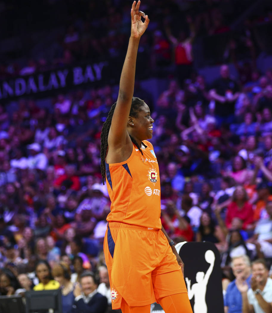 Connecticut Sun's Jonquel Jones celebrates after competing in an obstacle course involving pass ...