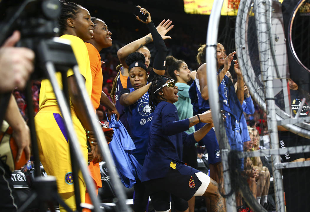 Players jump out of the way of a stray ball as they take turns competing during the WNBA All-St ...