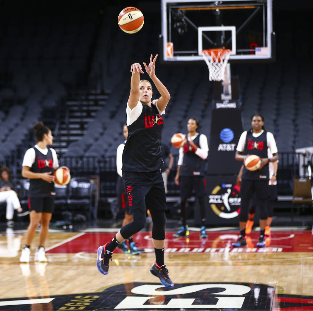 Washington Mystics' Elena Delle Donne shoots to score a half-court shot during practice ahead o ...