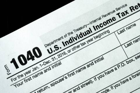 A 1040 tax form appears on display, Tuesday, Jan. 10, 2017, in New York. (AP Photo/Mark Lennihan)