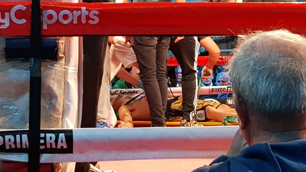 Argentine boxer Hugo Santillan is placed on a stretcher after he collapsed at the end of a WBC ...