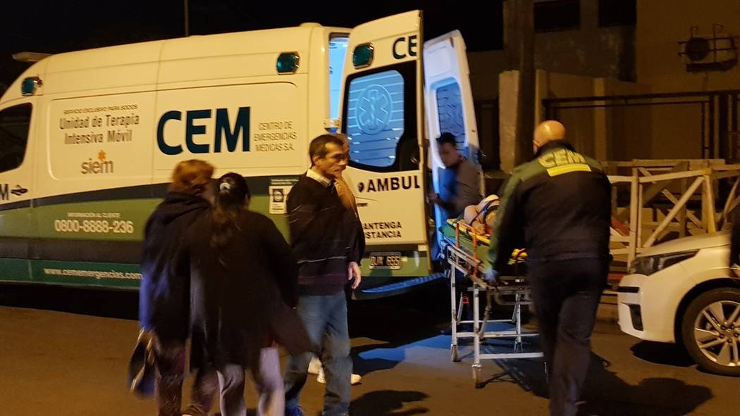 In this Sunday, July 21, 2019 photo, Argentine boxer Hugo Santillan is placed on an ambulance a ...