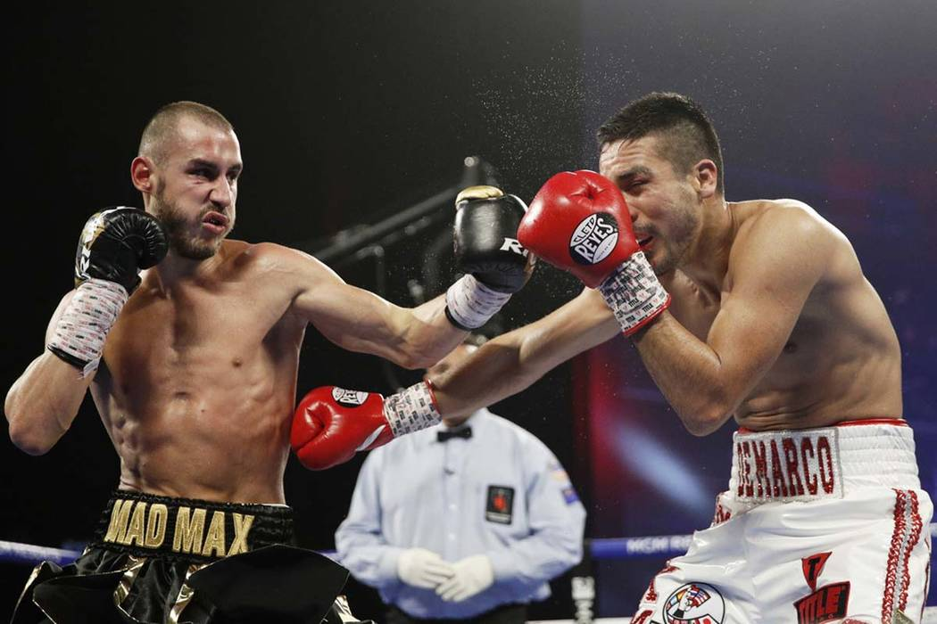 Maxim Dadashev of Russia, left, hits Antonio DeMarco of Mexico during a junior welterweight bou ...