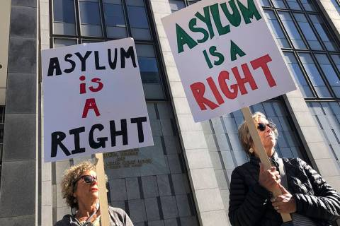 "Protestors hold signs that read "" Asylum is a Right"" outside of the San Francisco Federal Court ..."