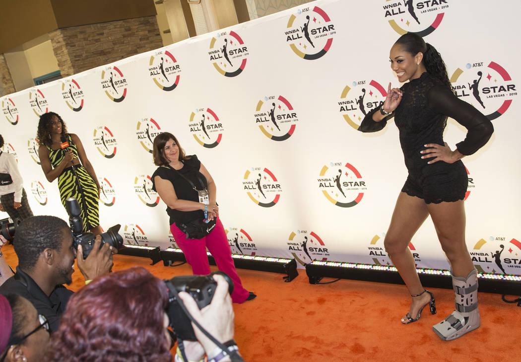 Las Vegas Aces forward A'ja Wilson, right, walks the WNBA Orange Carpet outside Della's Kitchen ...
