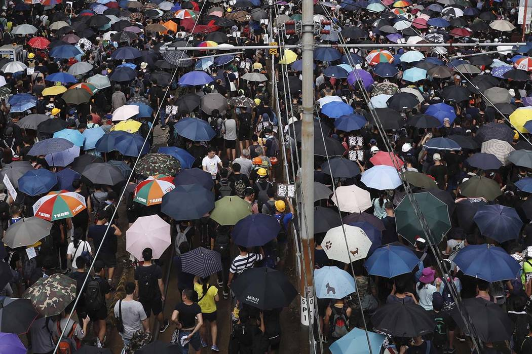 Protesters rally at Yuen Long in Hong Kong Saturday, July 27, 2019. Thousands of protesters beg ...